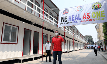 Mayor Francis Zamora gives a thumbs-up sign during the opening of a 52-room container van quarantine facility